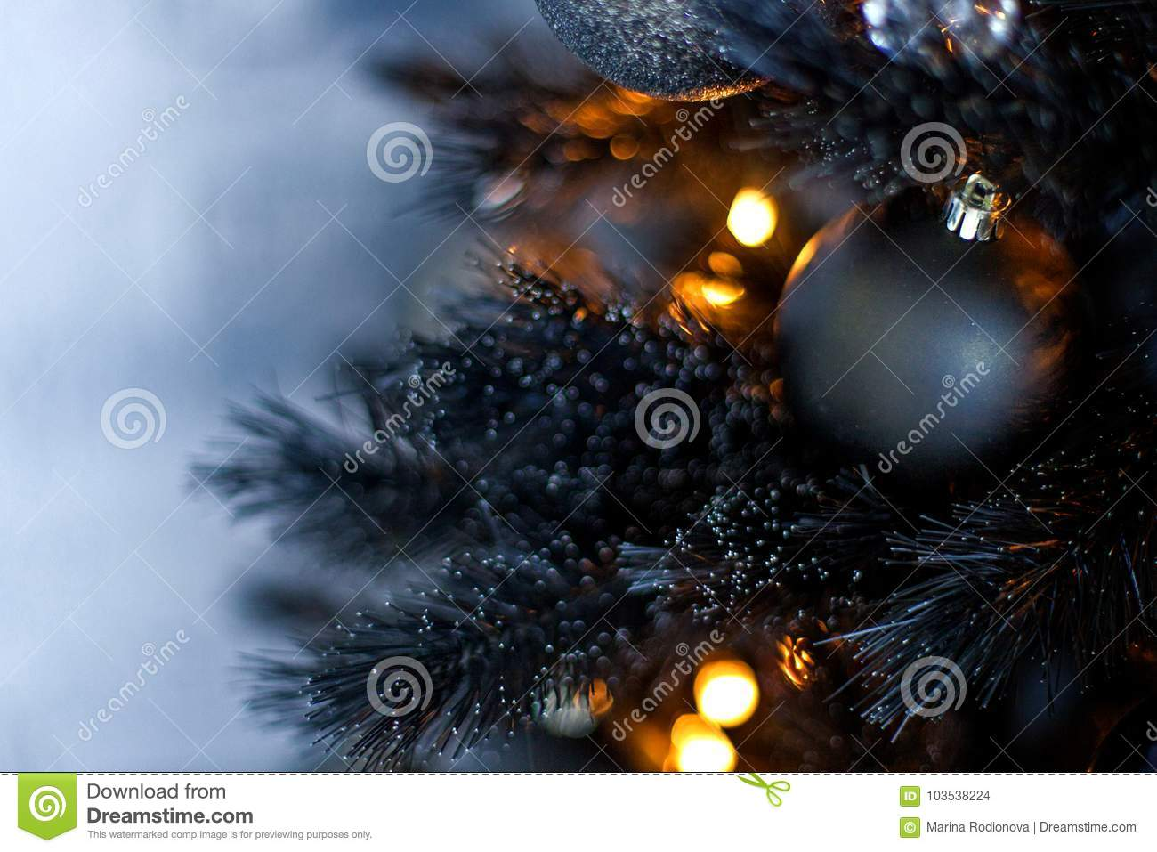 Christmas Dark Blurred Background With A Black Christmas Tree