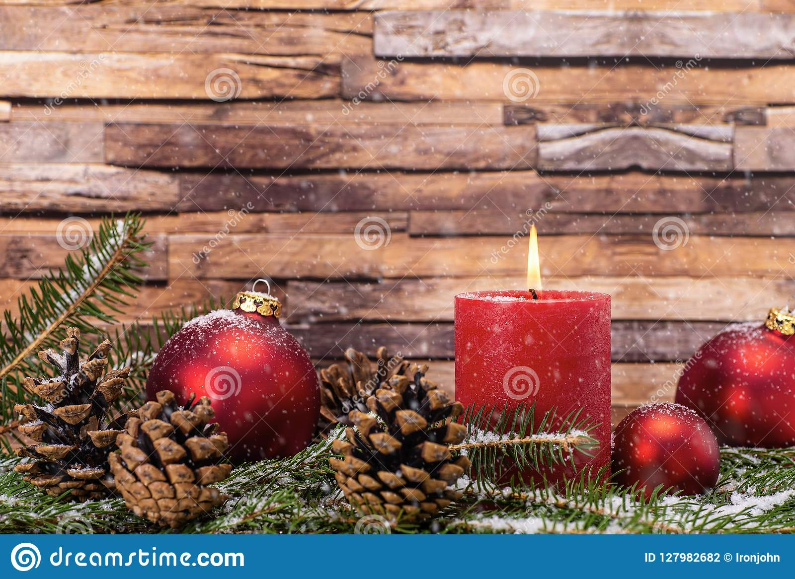 eef41a1e6bc1 Christmas Decoration With Candle And Snow Stock Photo - Image of ...