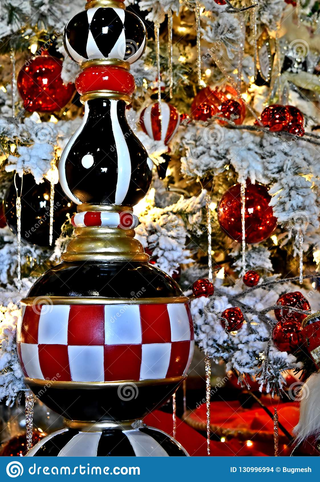 Christmas Decoration, checkerboard icicle ornament on white frocked tree