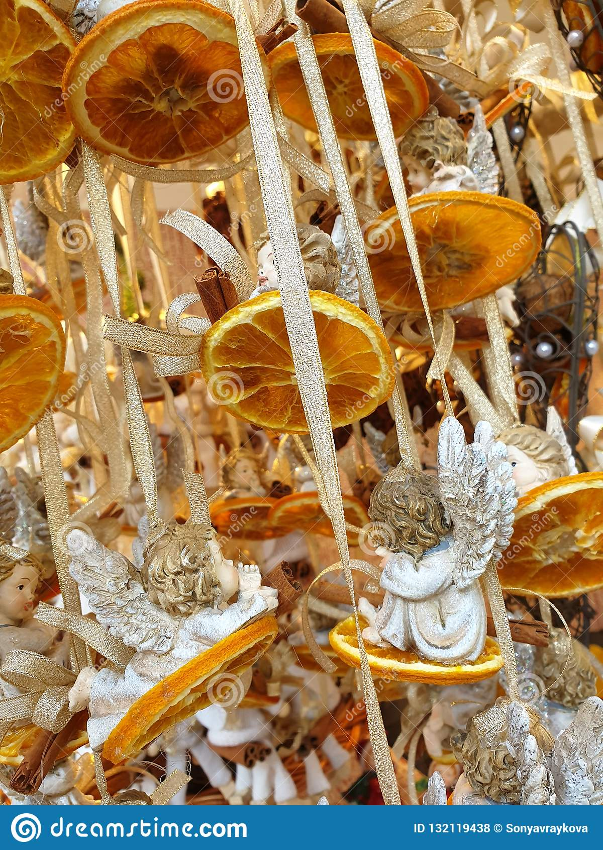 Christmas Decoration Of Dried Oranges And Ceramic Angels Stock Photo