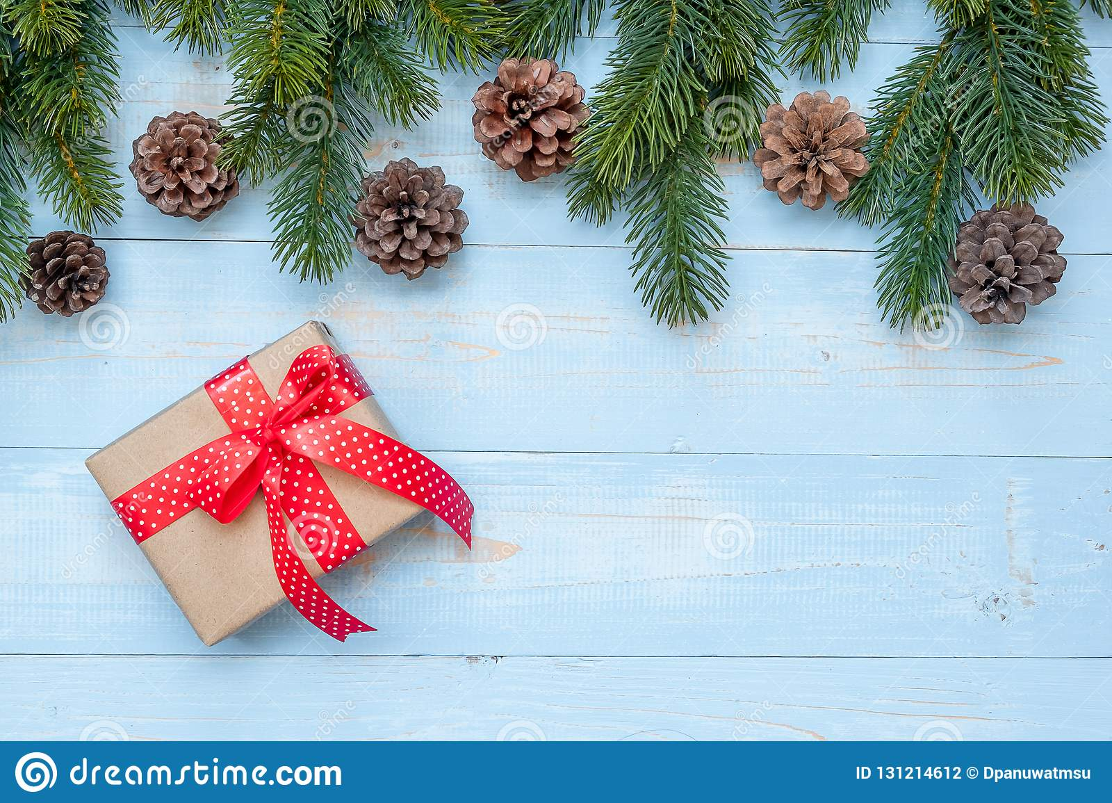 Christmas decoration, gift box and pine tree branches on wooden background, preparation for holiday concept, Happy New Year and Xm