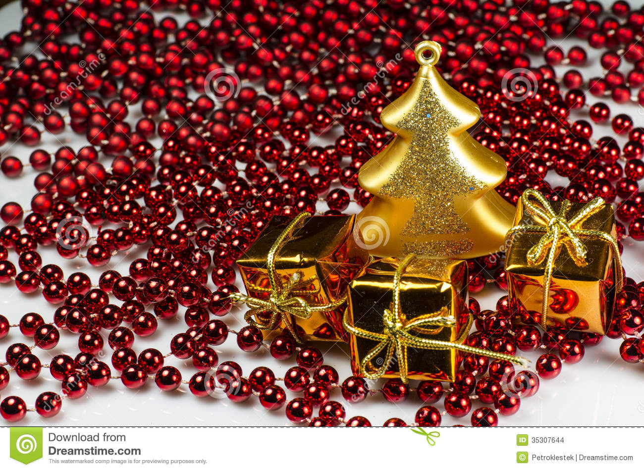 christmas decoration - gold glass tree and 3 giftboxes with chain stock photo