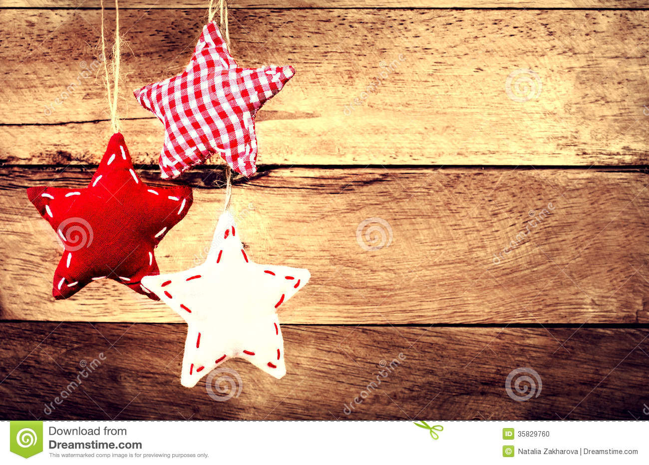 Christmas decoration hanging over rustic wooden background