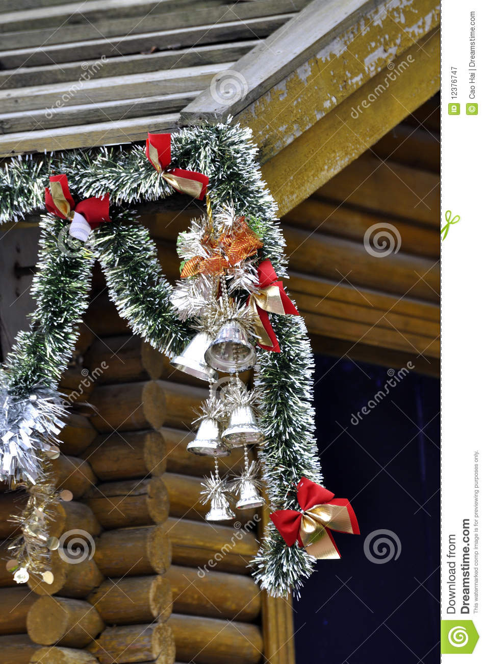 Rooftop Christmas Decorations : Christmas decoration made in bell and colorful branch, hanging on a ...