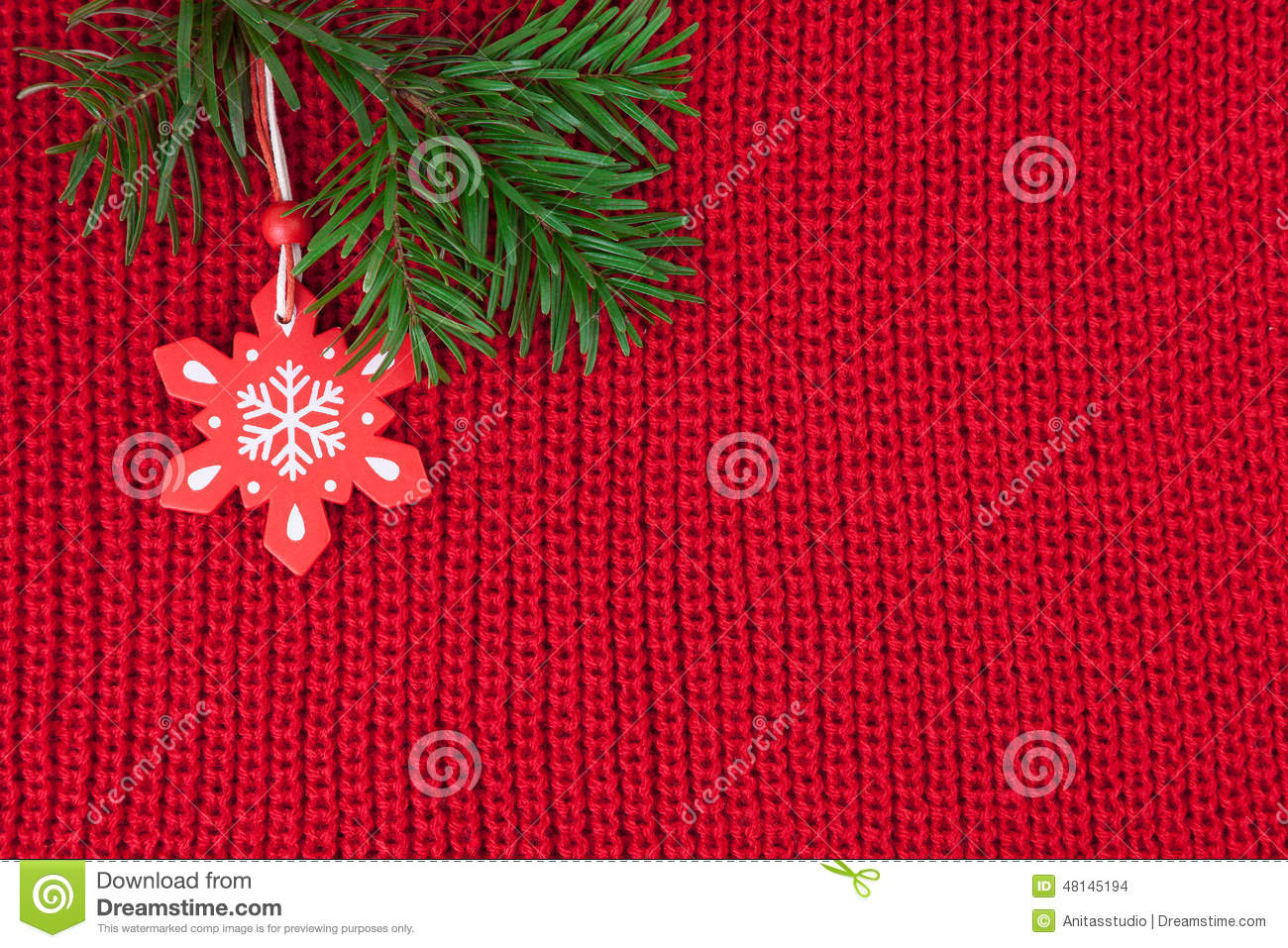 Christmas Knitting Background : Christmas decoration over red wool knitted fabric stock