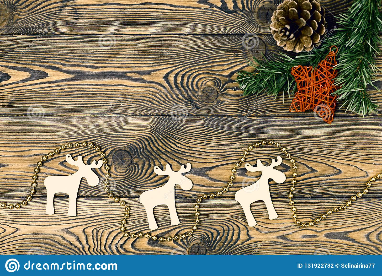 Christmas decoration over a wooden background, vintage toning. Flat lay, copy space