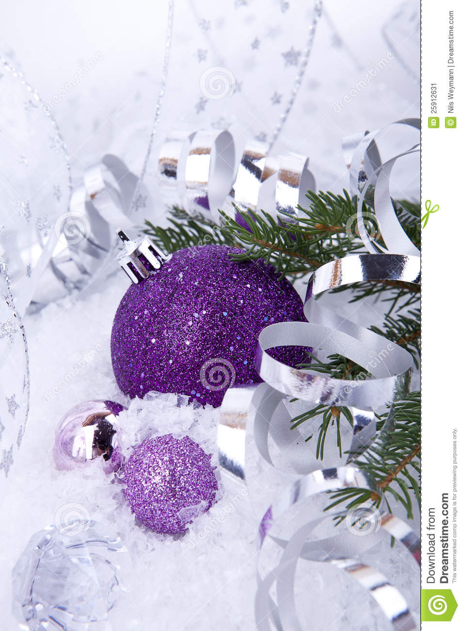 Beautiful christmas decoration in purple and silver on white snow ...