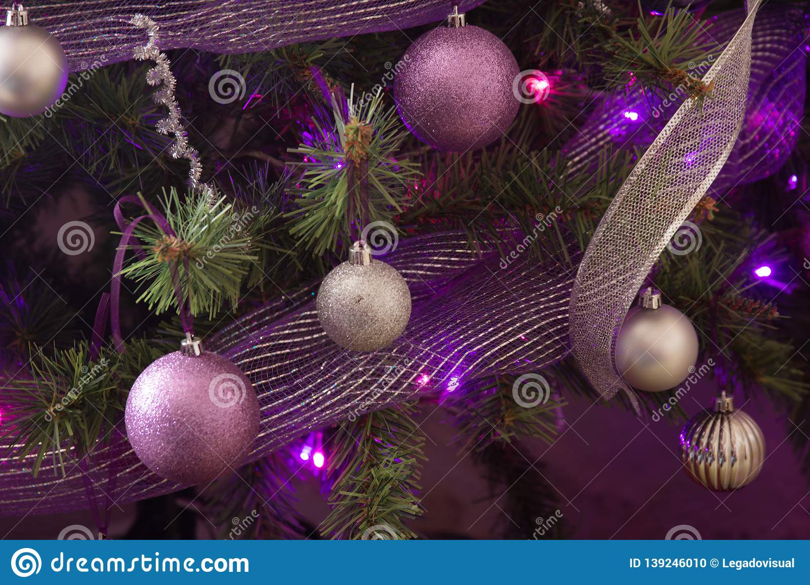 Purple And Silver Christmas Trees.Christmas Decoration In Purple And Silver Stock Photo