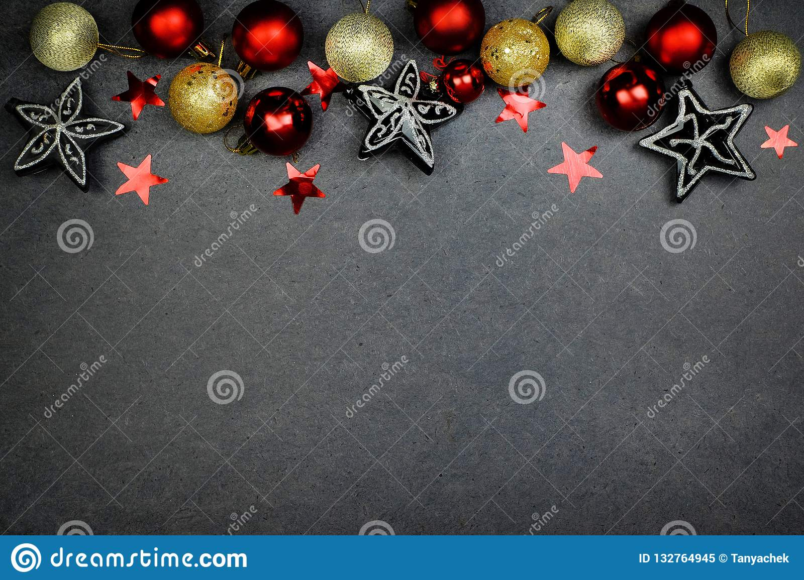 61f2dfcbc254 Christmas decoration, red balls and black silver stars on the white  background. Flat lay. Copy space. Top view.