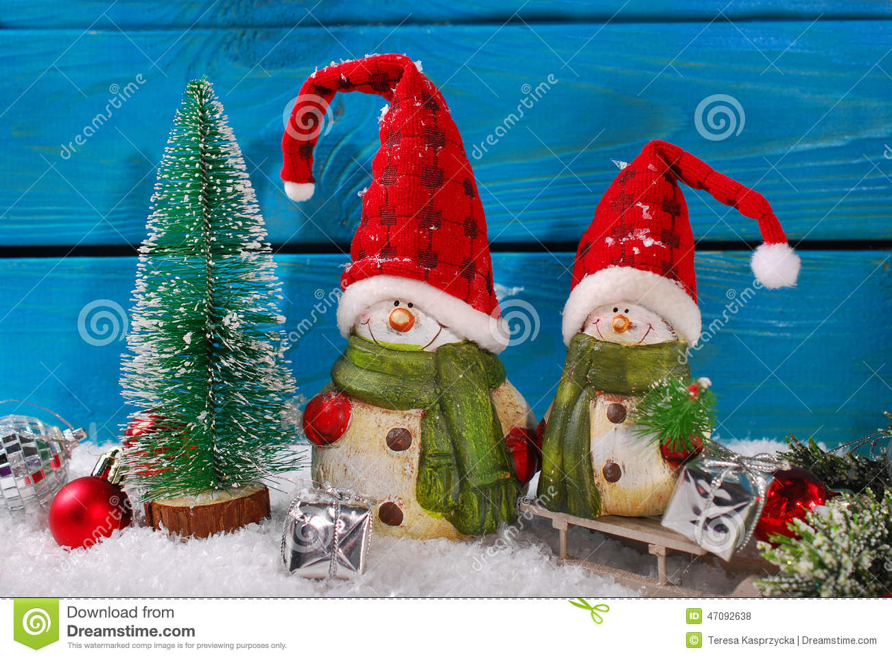 Christmas Decoration With Two Funny Santa Claus Figurines On Blue Wooden Background