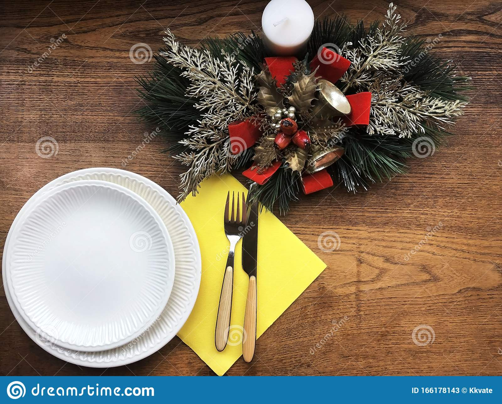 Christmas Decoration On Wooden Table Festive Dinner Setting White Empty Plates Cutlety Candle And Christmas Wreath Wooden Tab Stock Image Image Of Present Candle 166178143