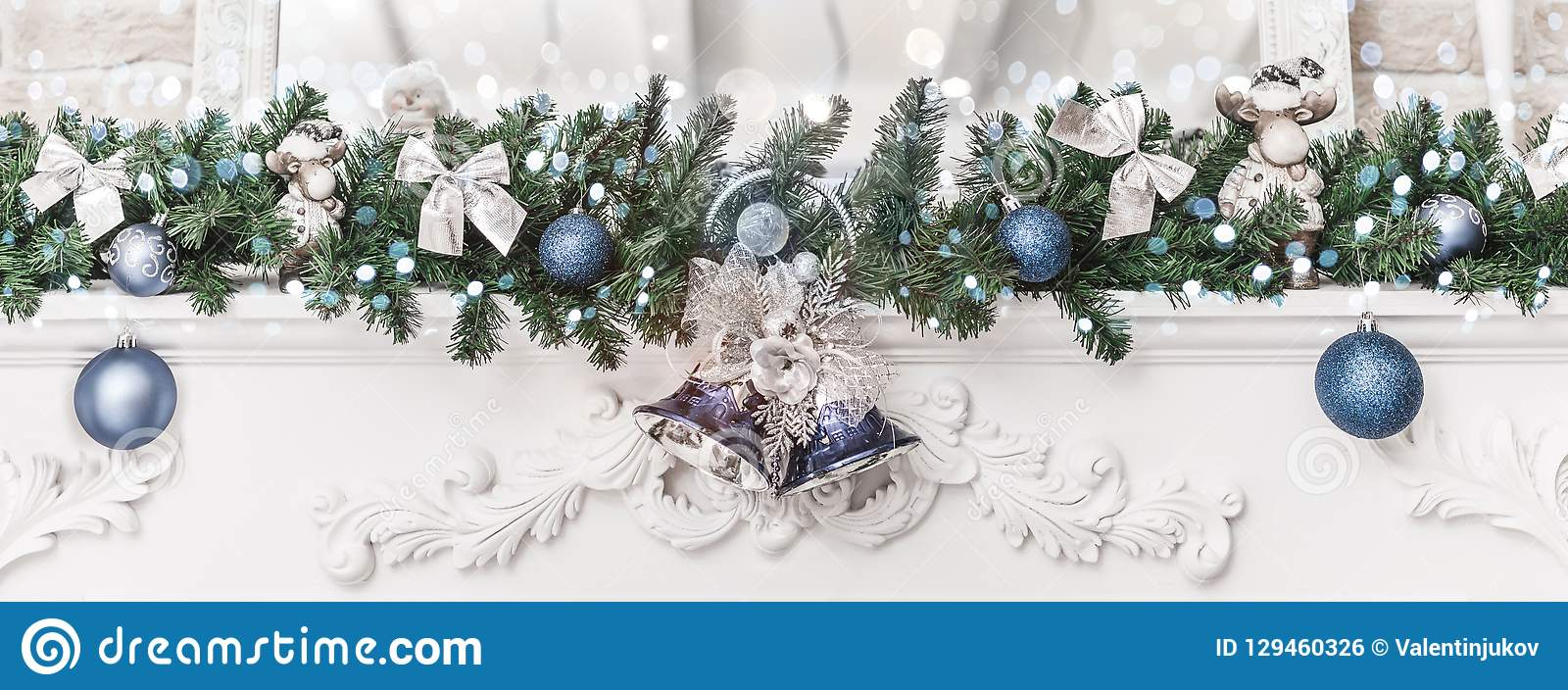 Christmas decorations with bells and balls, sparking, glowing holiday background. Happy New Year and Xmas theme.