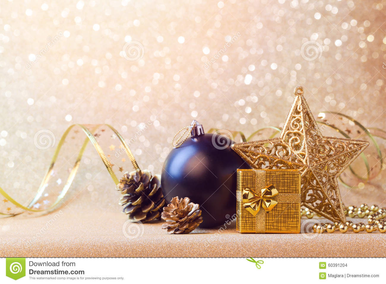 christmas decorations in black and gold over glitter background