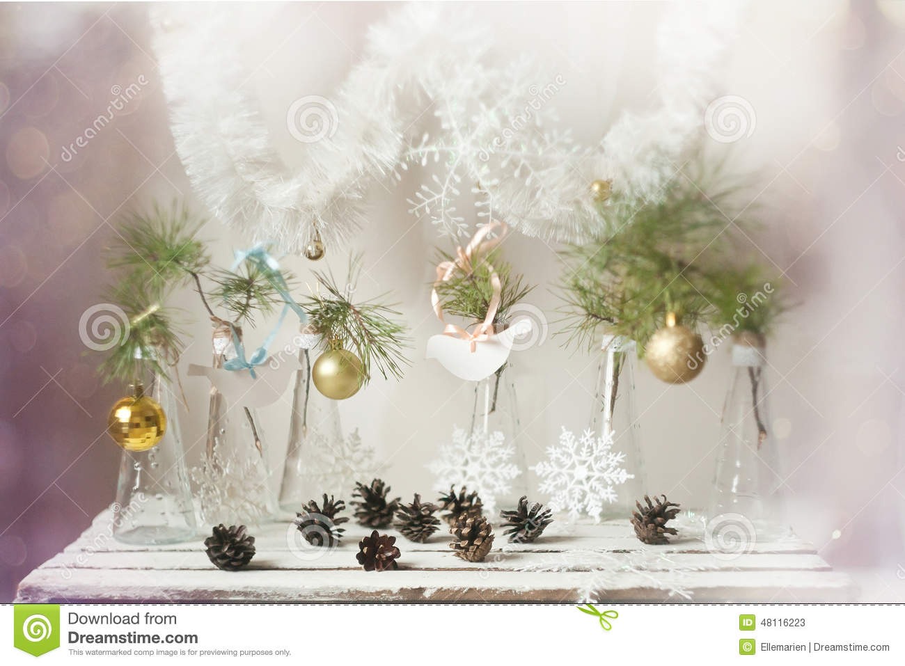 Gold Bird Christmas Tree Decorations : Christmas decorations on a branch of tree in glass vases