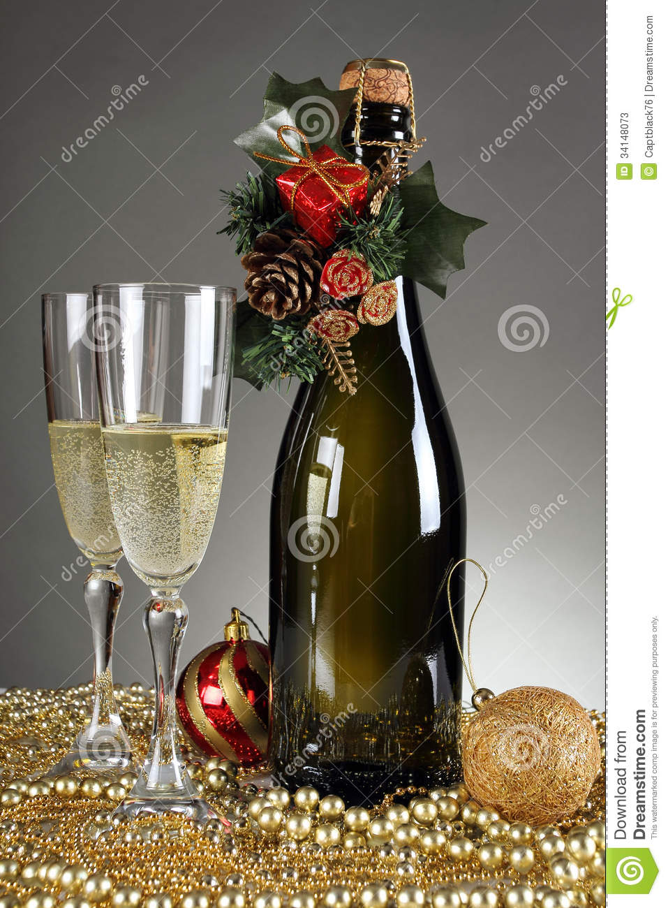 Christmas decorations and a champagne bottle stock image for Christmas bottle decorations