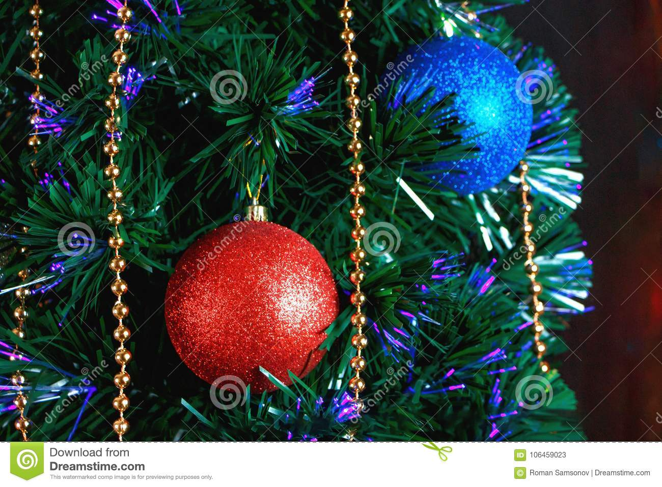 Christmas Decorations On The Christmas Tree On The Background Of ...