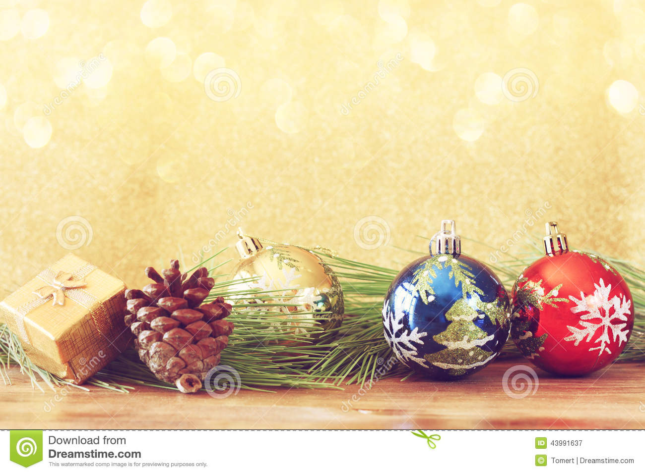 christmas decorations and fir on a wooden board top view