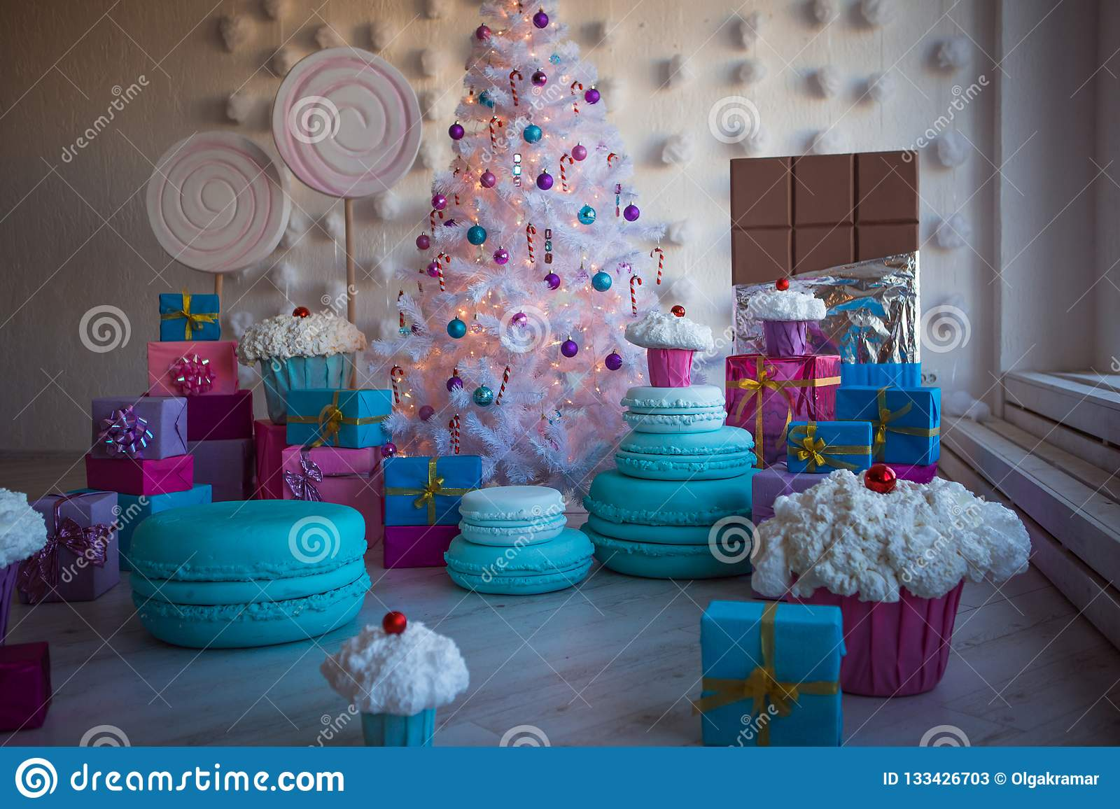 Christmas Decorations In The Form Of Cakes And Large Chocolate Christmas Toys On A White Artificial Christmas Tree Stock Image Image Of Birthday Cupcake 133426703