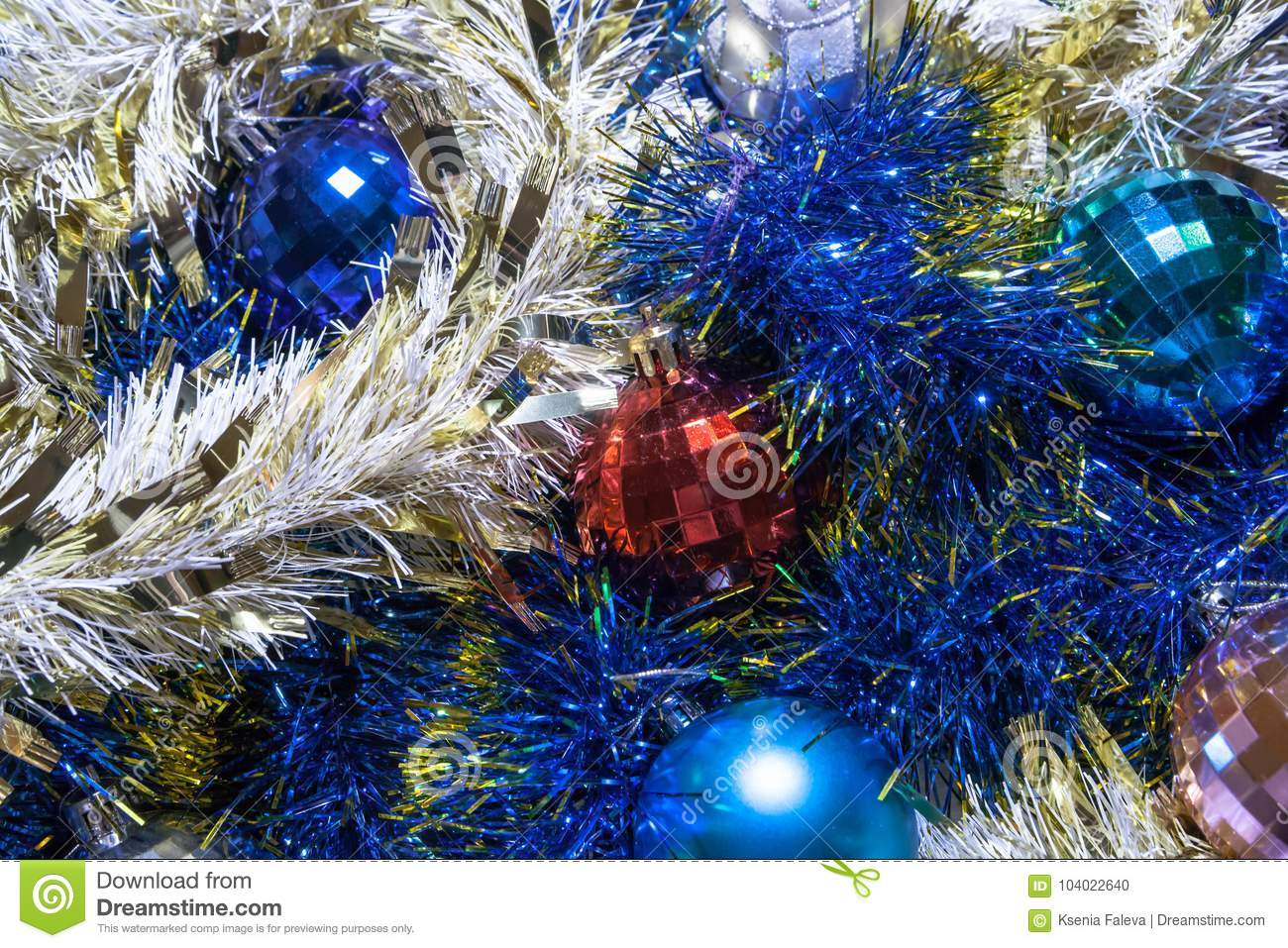 christmas decorations garlands are blue and gold the balls are red and blue