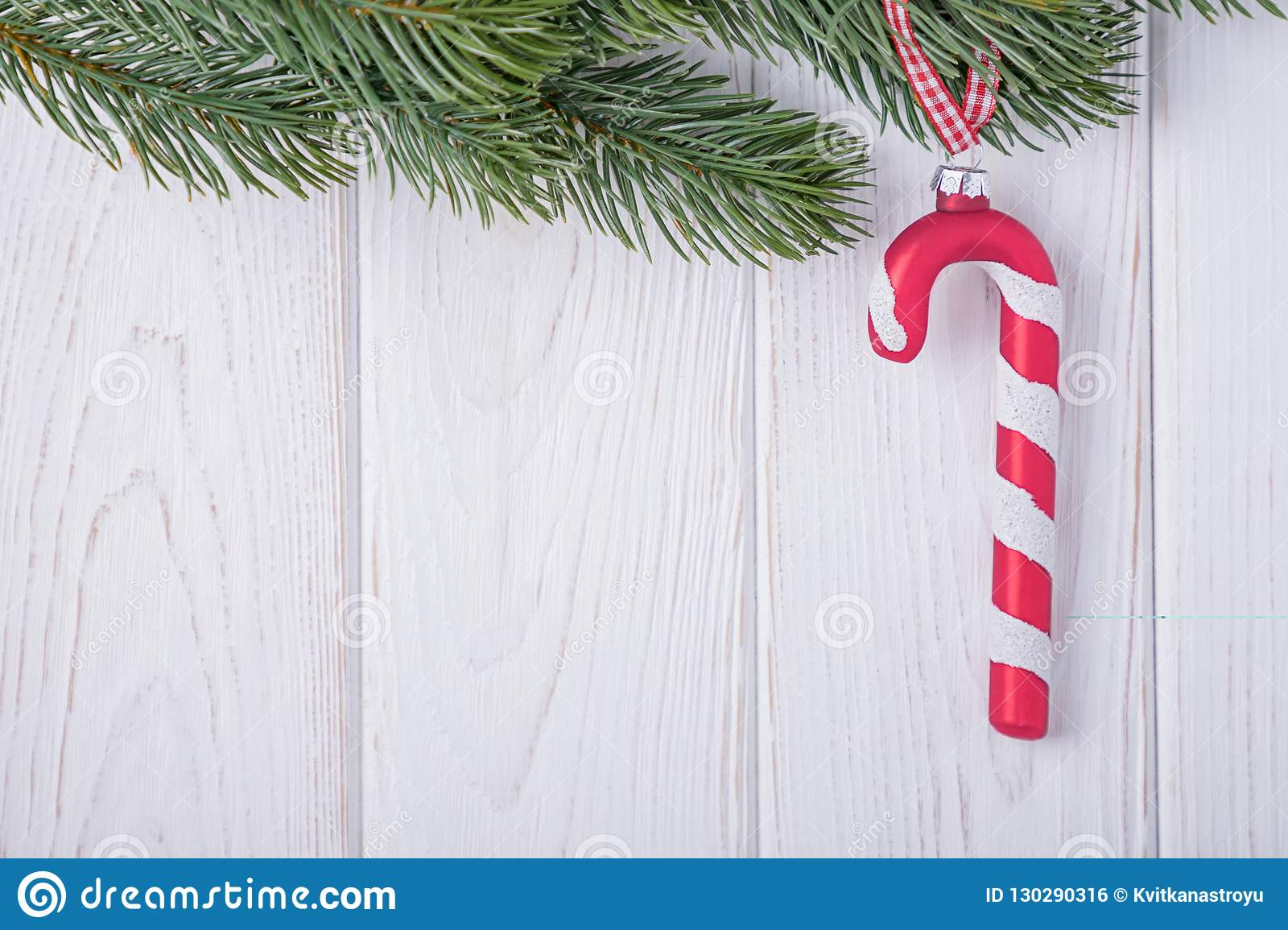 christmas decorations glass candy cane and christmas tree branch on