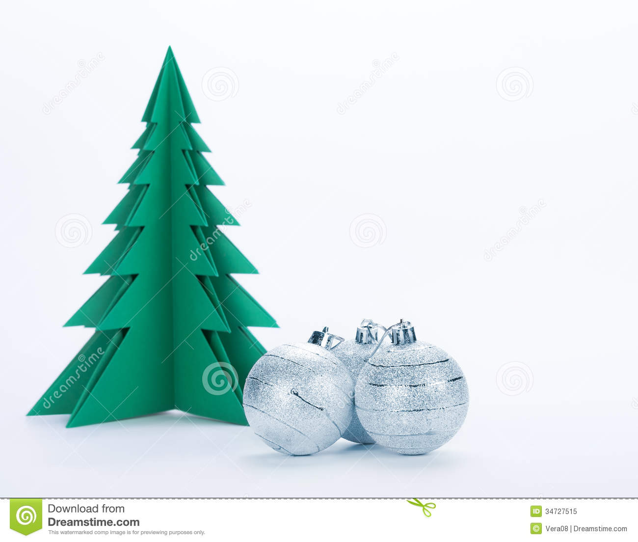 christmas decorations and green paper tree on a white background - Old Fashioned Paper Christmas Decorations
