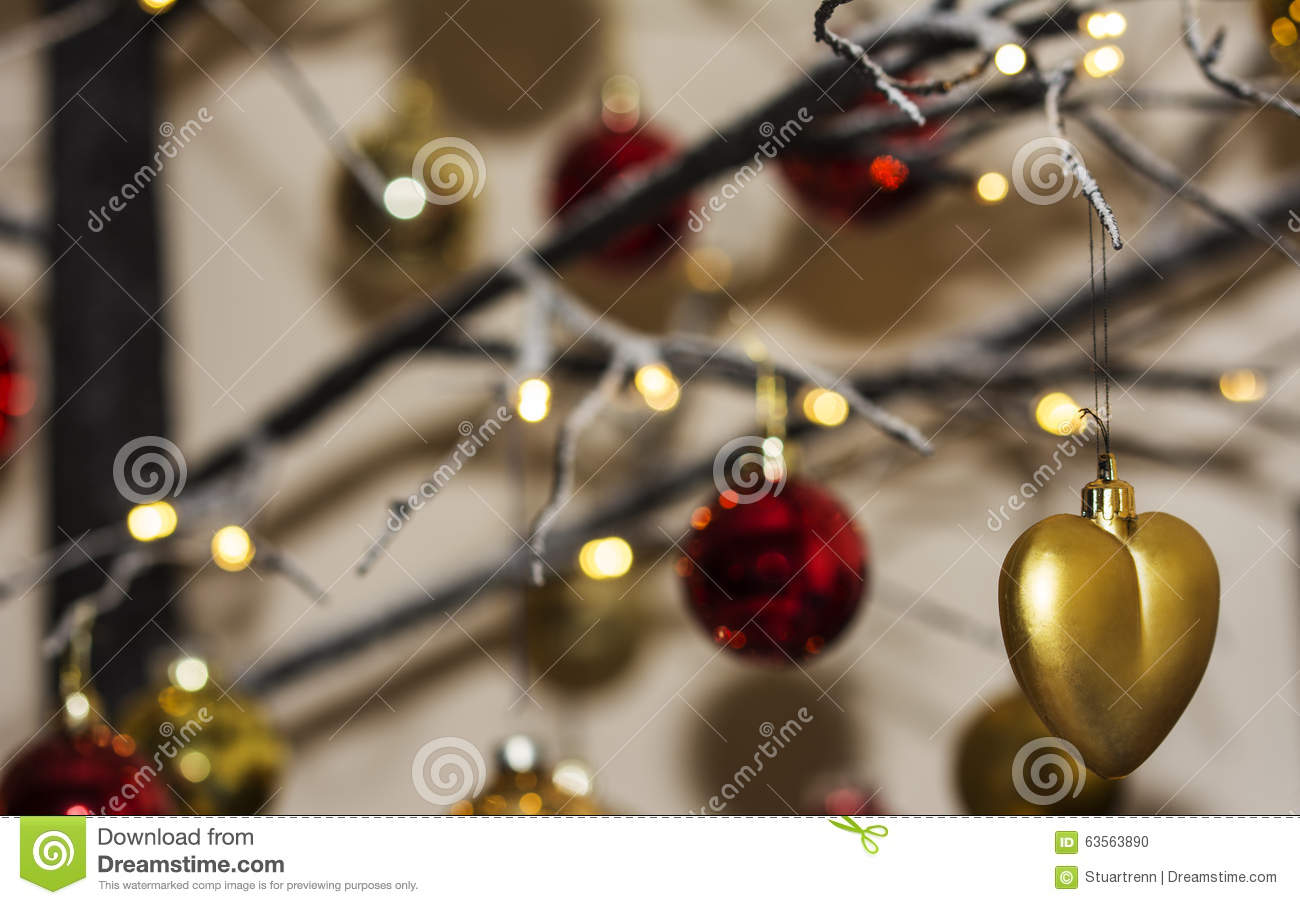 christmas decorations hanging from contemporary christmas tree