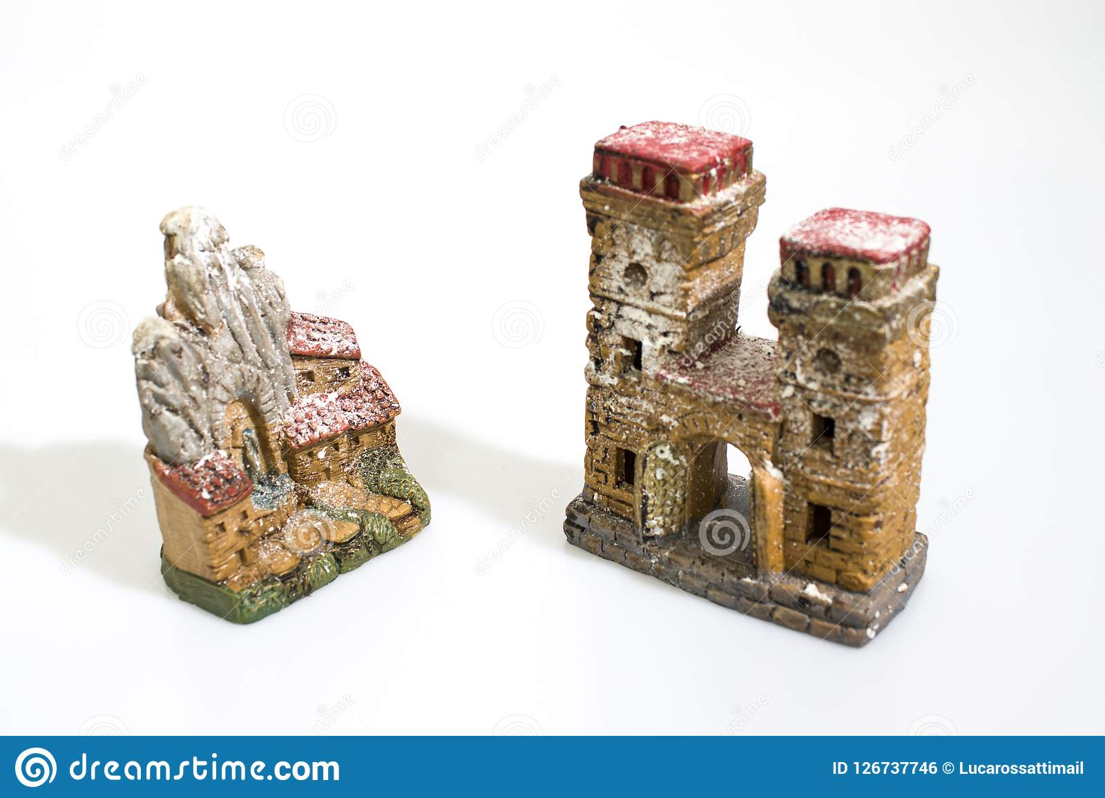 Christmas decorations, nativity scene houses isolated in a white