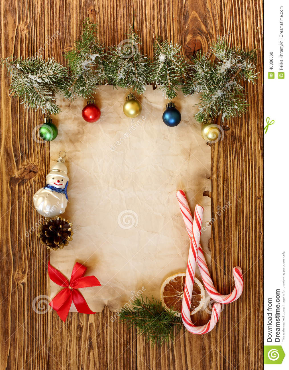 Christmas Decorations On The Old Sheet Of Paper On A Wooden