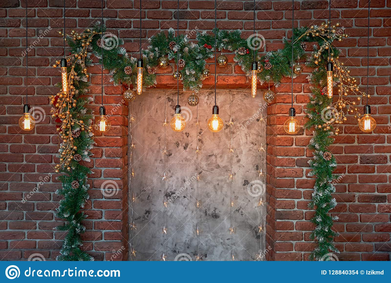 Christmas decorations over the decorative fireplace on the wall