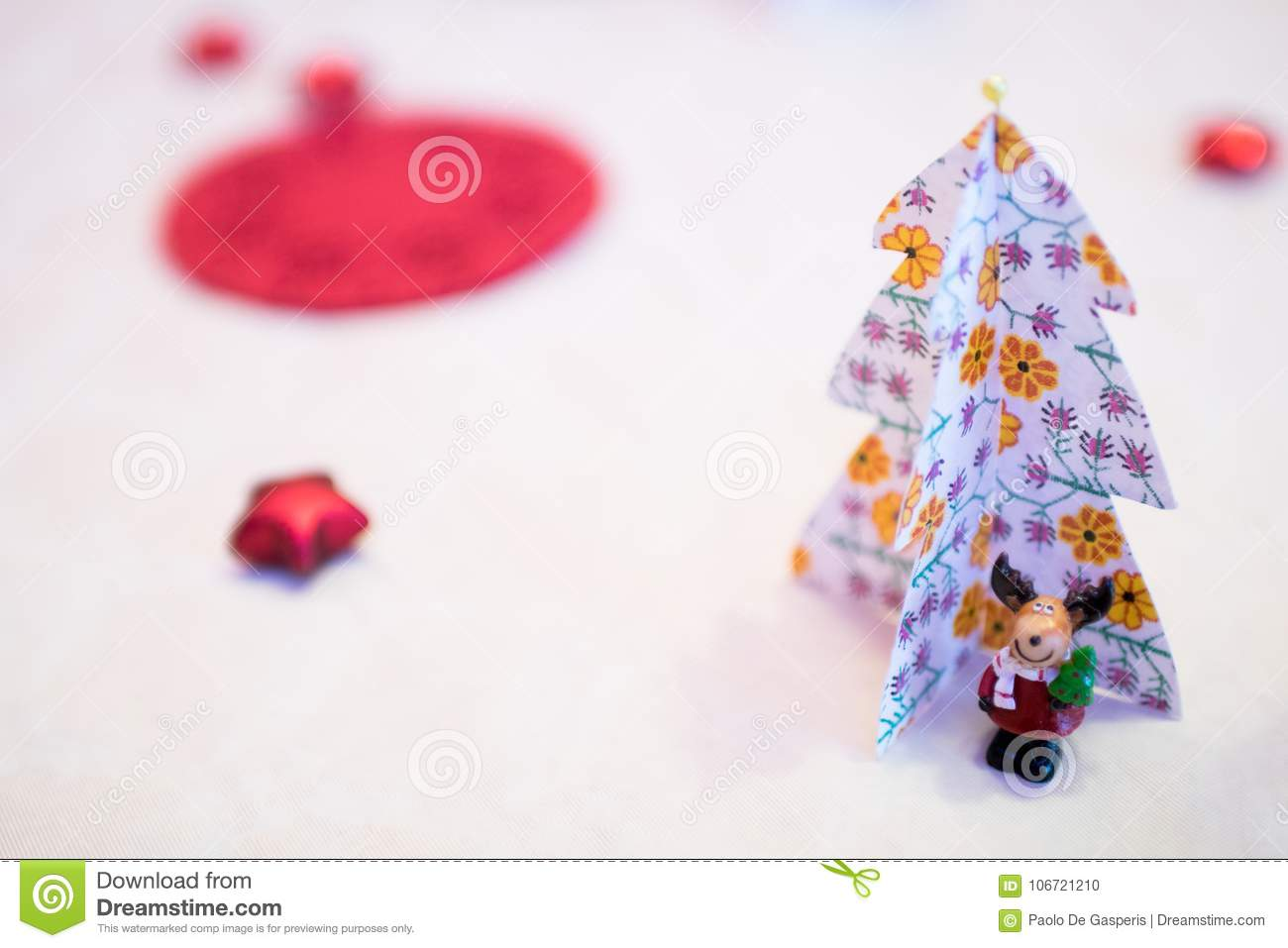 christmas decorations with paper christmas trees and a reindeer mascot dressed as santa claus under a handmade paper tree decorations for a white table of - Handmade Paper Christmas Decorations