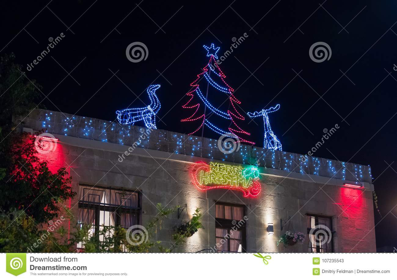 download christmas decorations on the roof of a house on the sderot ben gurion street in