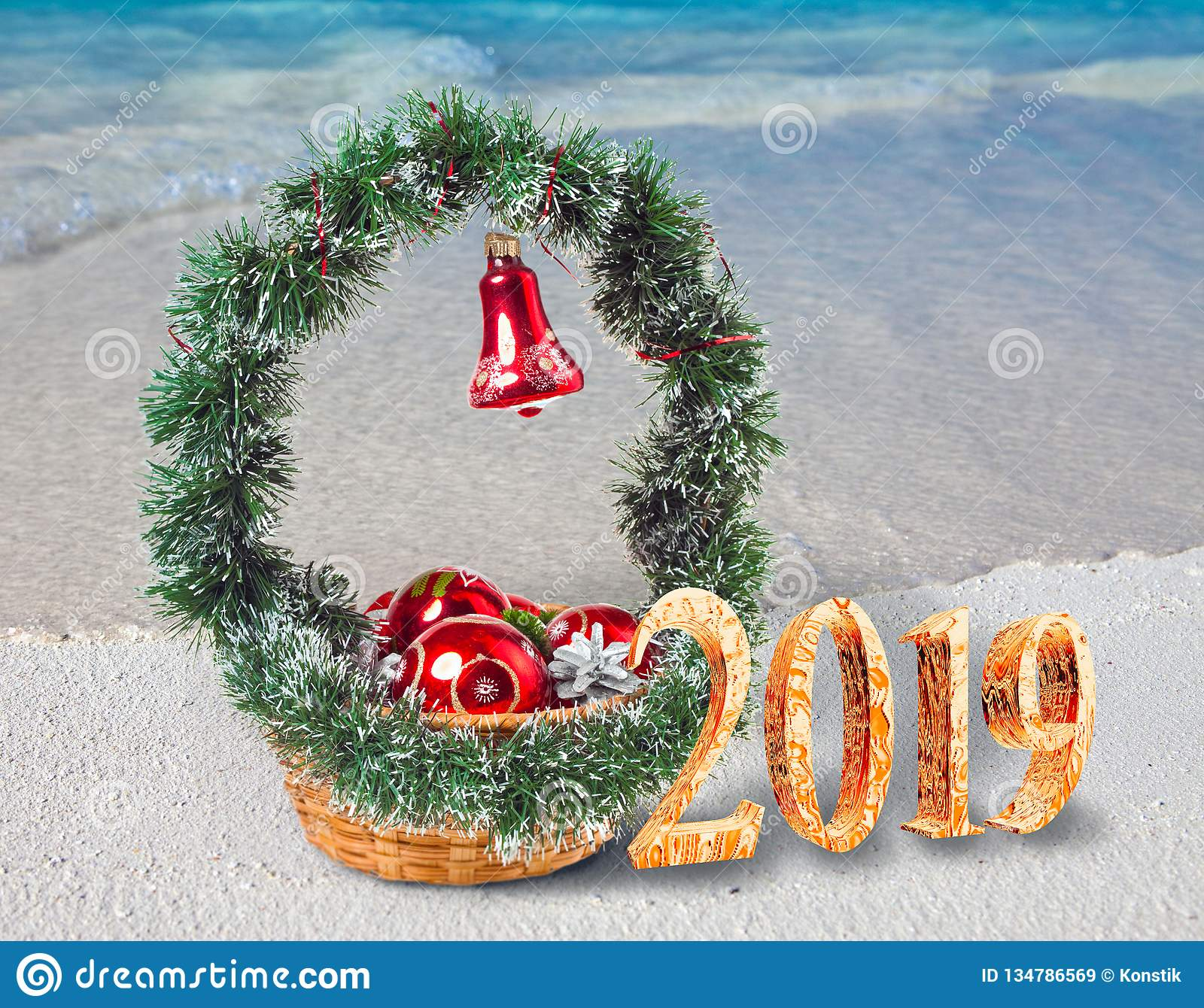Christmas Decorations On The Sandy Seashore And The Inscription 2019