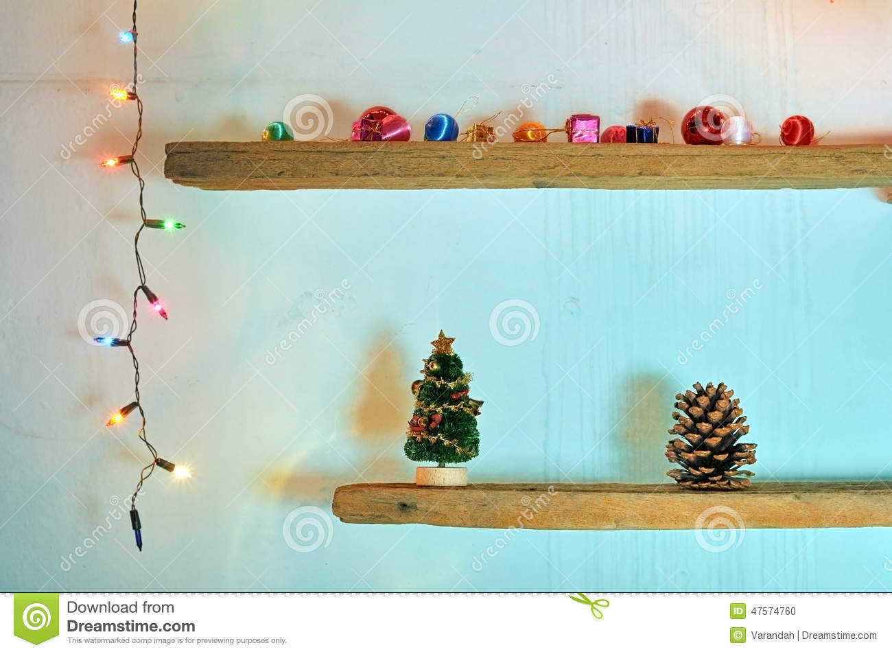 christmas decorations on shelf with christmas light