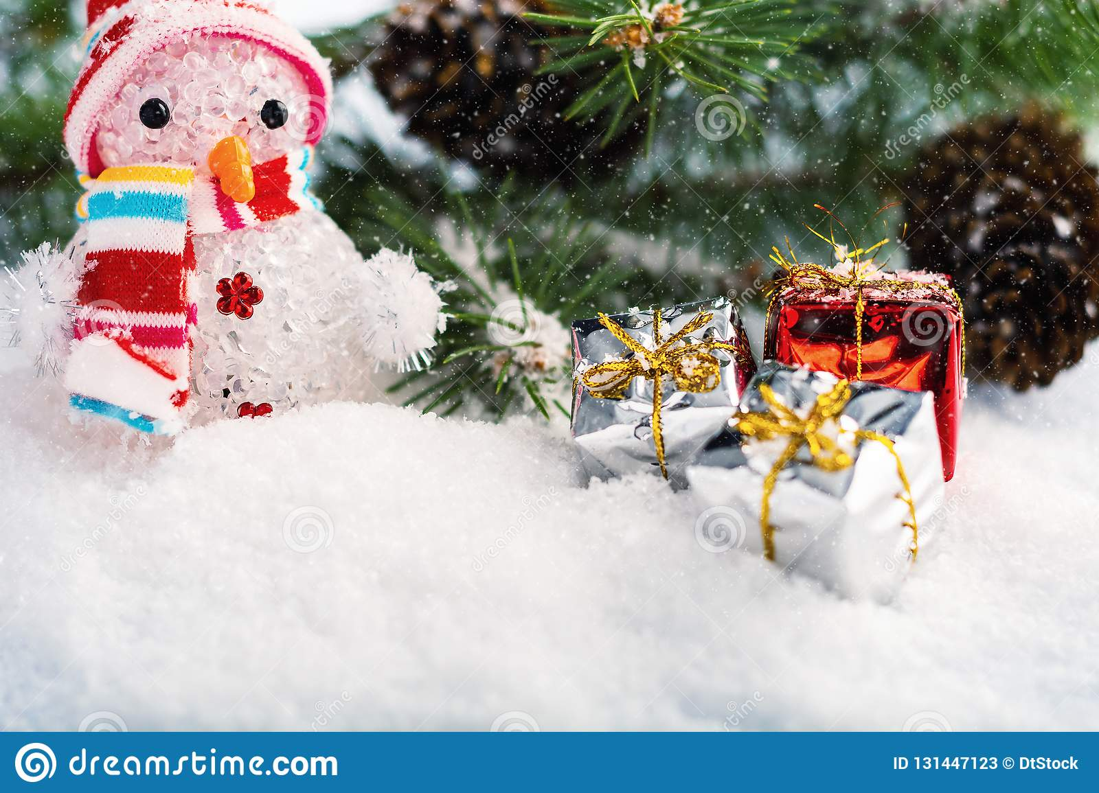 Christmas Decorations with snowman, christmas tree, fir-cone and christmas baubles