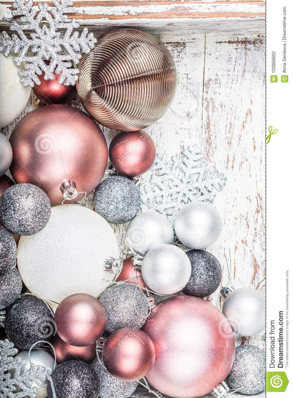 christmas decorations in the wooden box as a preparation for decorating the xmas tree pastel colors top view - Pastel Christmas Decorations