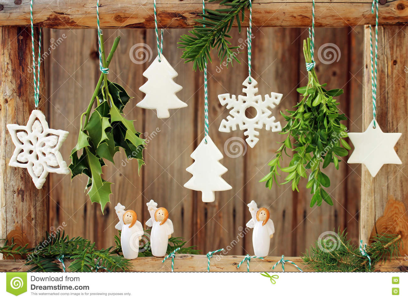 christmas decorations on wooden fence