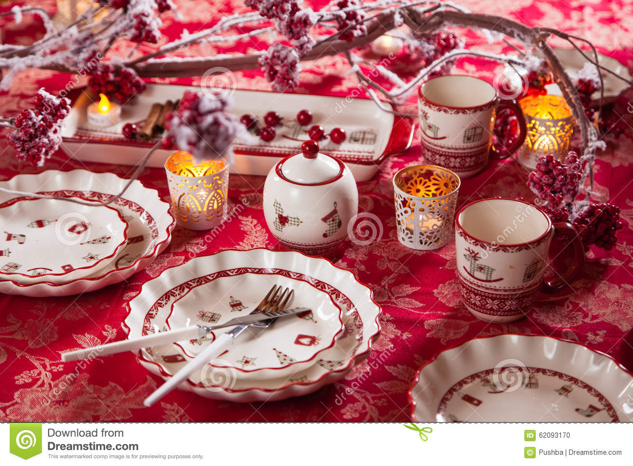christmas dishes cutlery and decor in red and white stock photo image 62093170. Black Bedroom Furniture Sets. Home Design Ideas