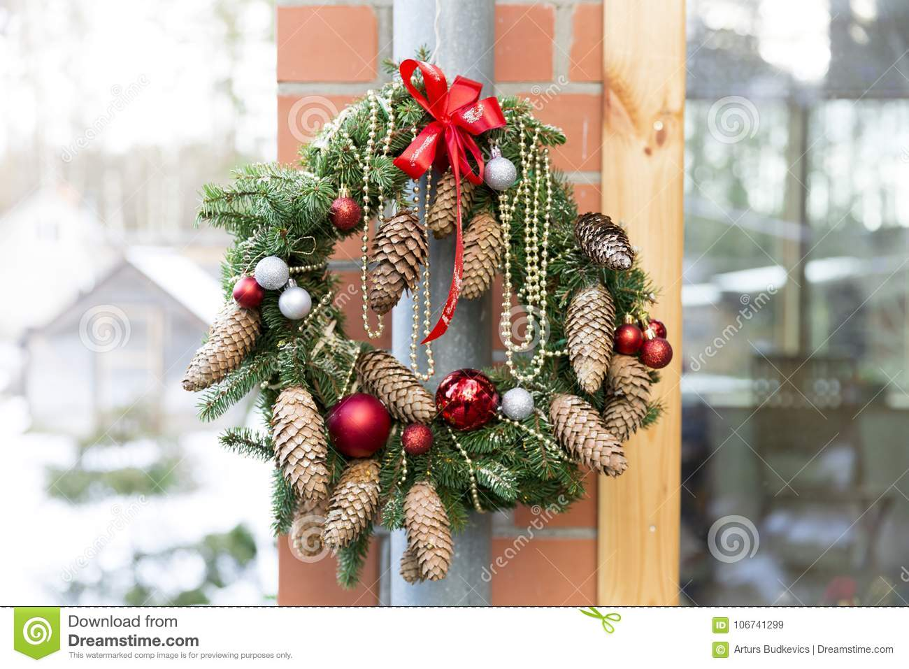 Christmas Door Wreath With Pines And Christmas Decorations Stock