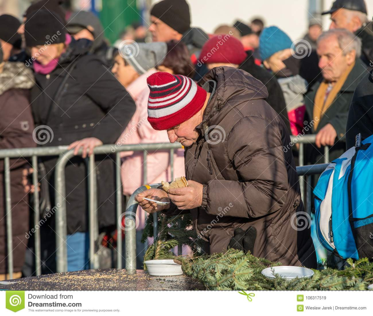 Christmas Eve for poor and homeless on the Main Square in Cracow.