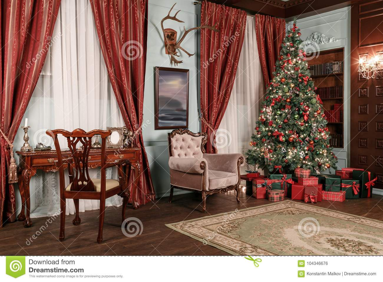 christmas evening classic apartments with a white fireplace decorated tree sofa large windows and chandelier