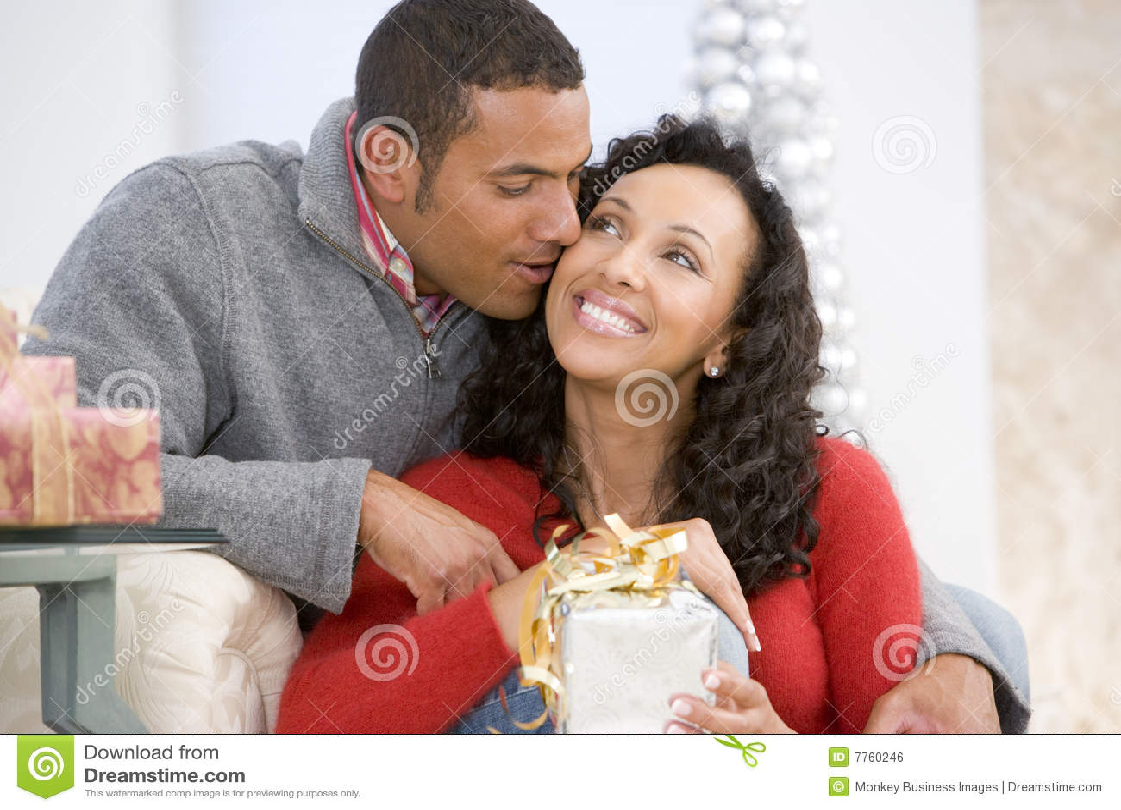 Christmas exchanging gifts husband wife