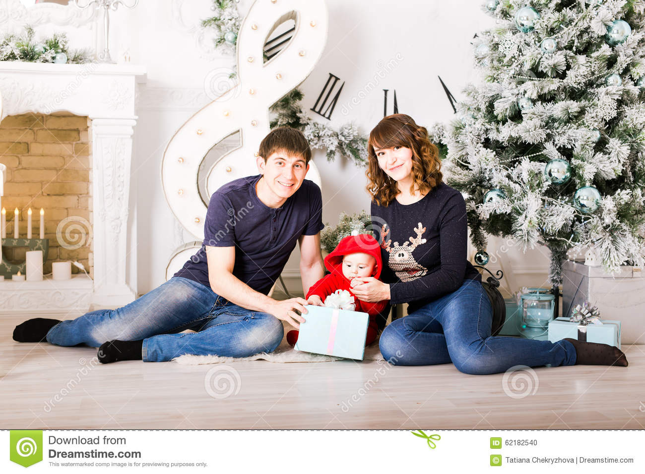 Christmas Family With Baby Opening Gifts. Happy Stock ...