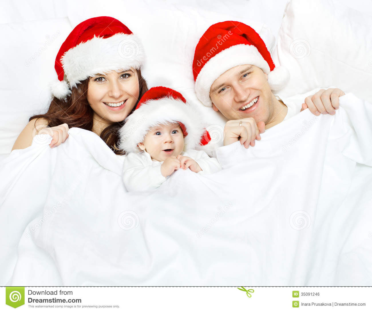 Christmas Family Photo Christmas Family And Baby In Santa Claus Hat Over White Royalty
