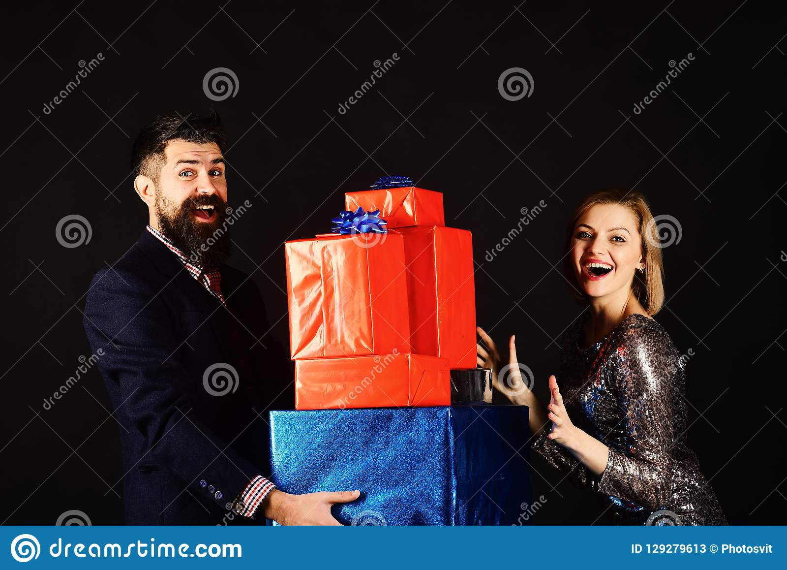 Christmas family concept. Couple in love holds stack of presents