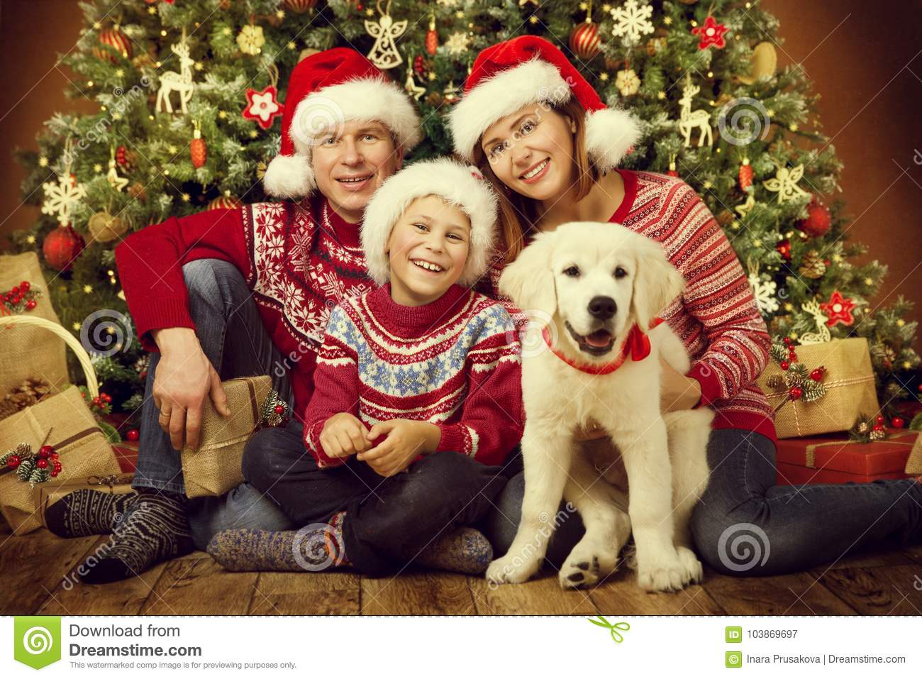 Christmas family with dog, happy father mother child portrait