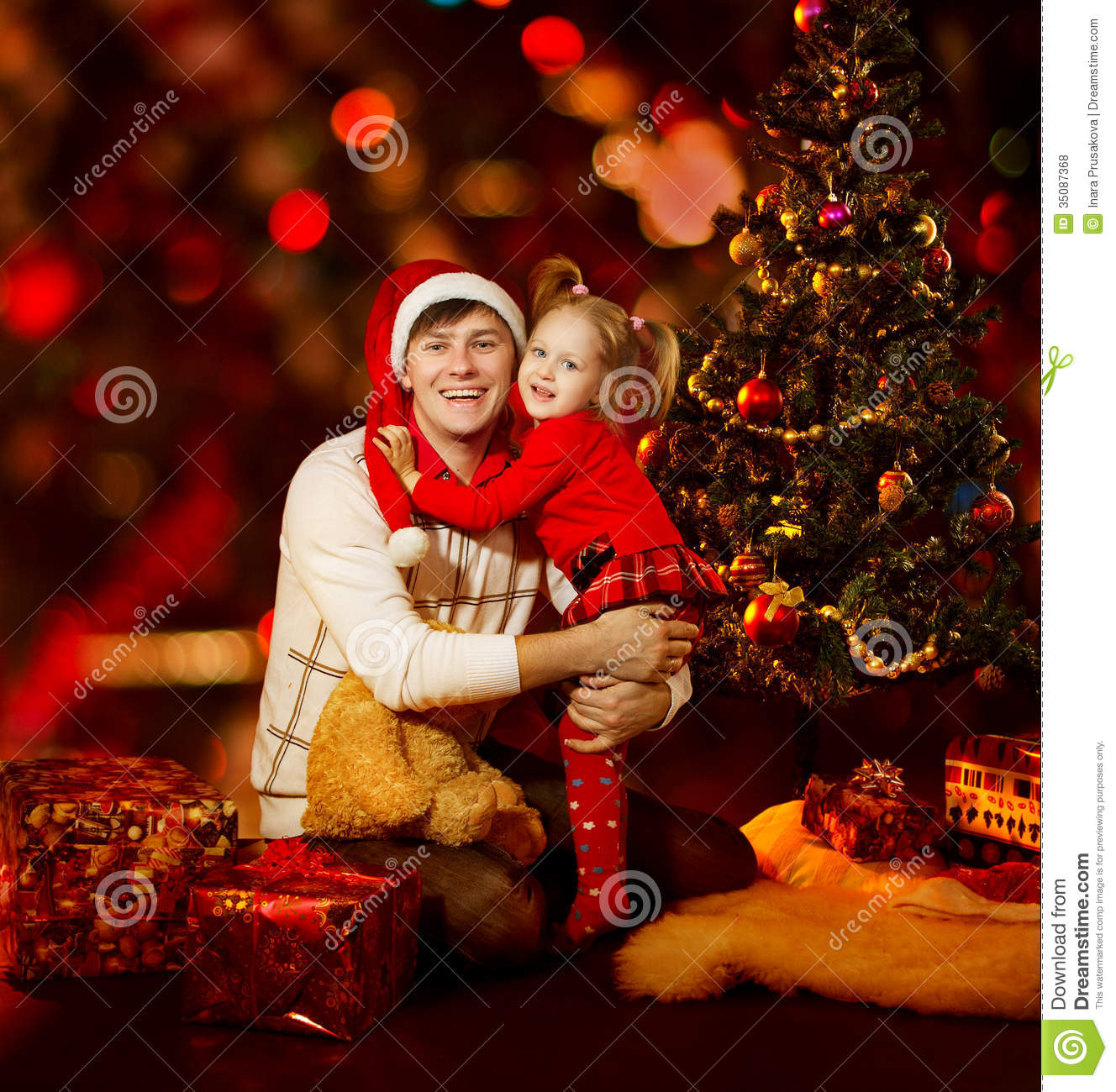 Christmas Family Photo Christmas Family Father And Daughter Child Under Xmas Tree Red