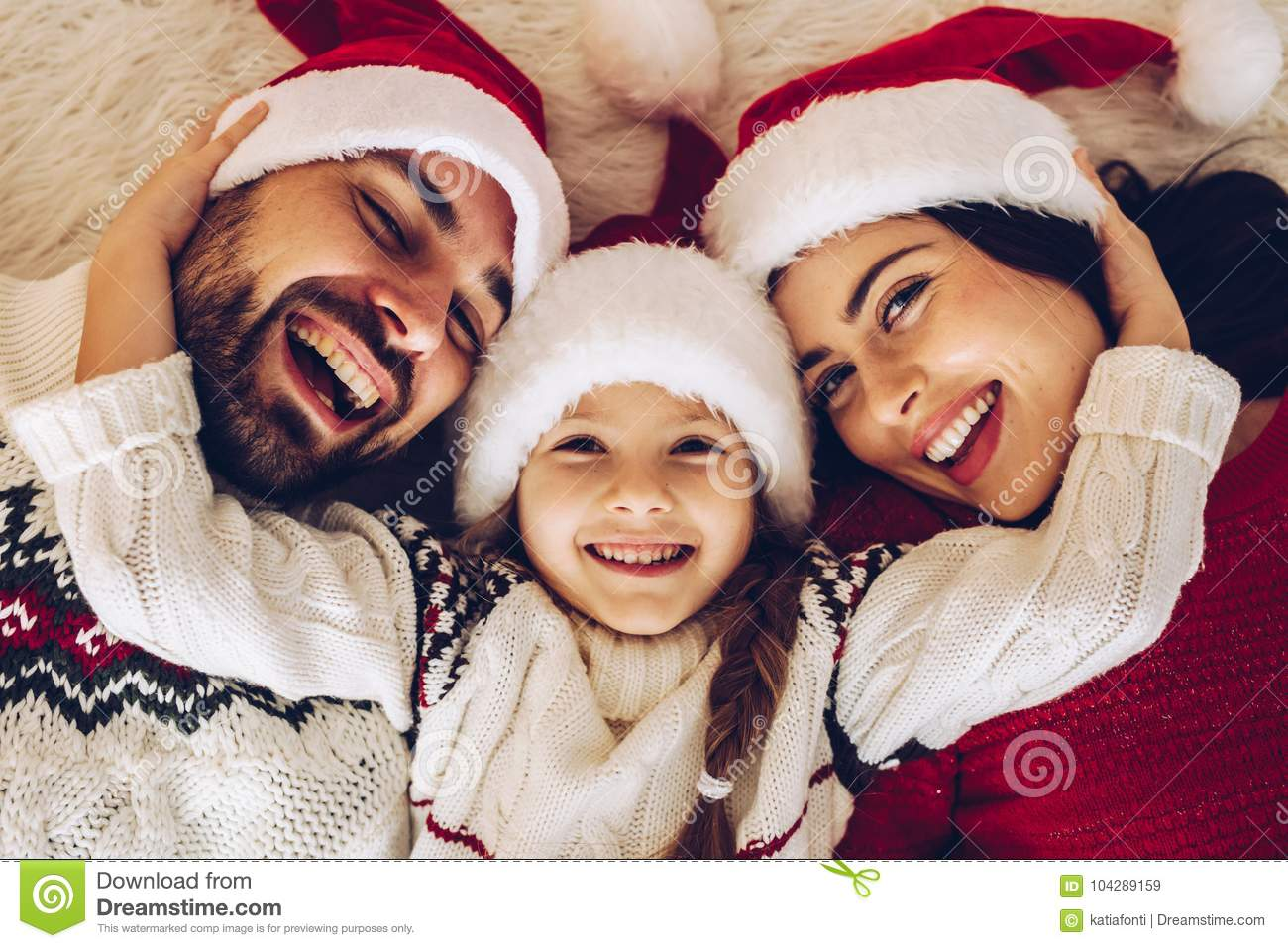 Christmas family! Happy mom, dad and little daughter on Santa Cla
