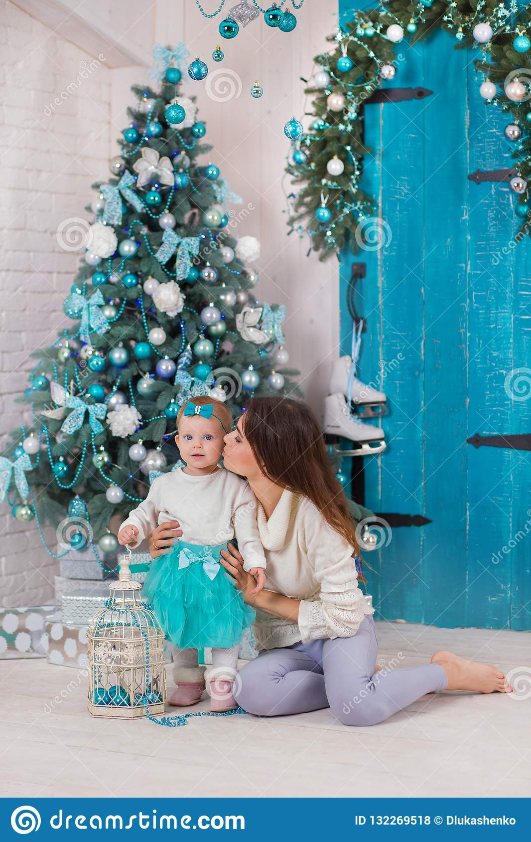 Christmas Family At Homely Cozy House Posing Close To New Year Tree Colored In Blue Beautiful Woman With Cute Baby Daughter In Stock Photo Image Of Love Christmas 132269518