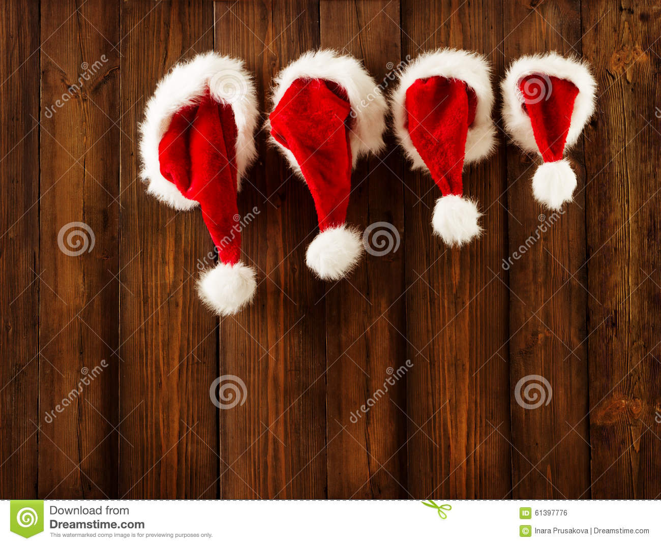 Christmas Family Santa Claus Hats Hanging On Wood Wall