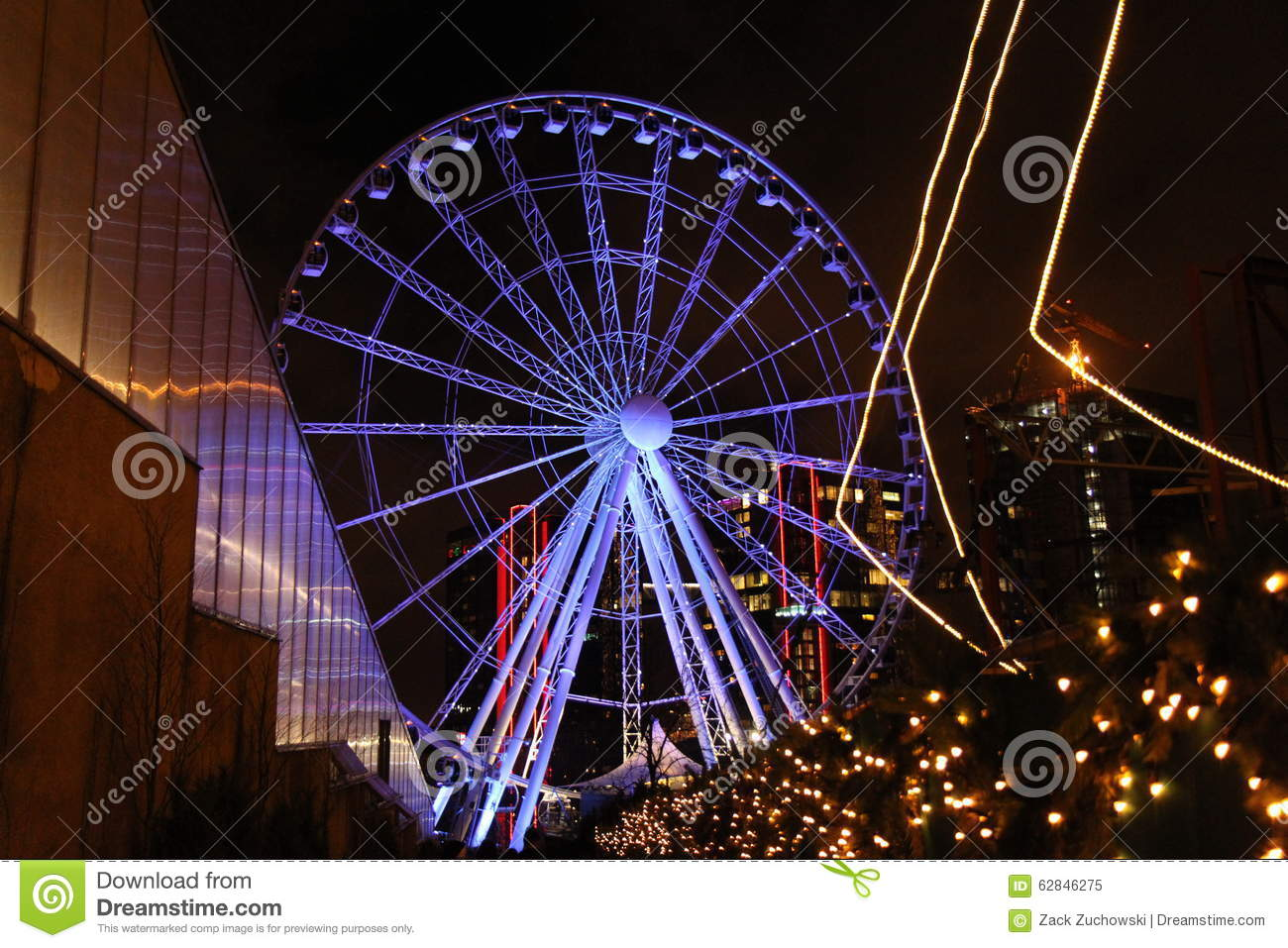 christmas lights and decorations at liseberg amusement park in gothenburg sweden with a view of a ferris wheel christmas trees stars and buildings